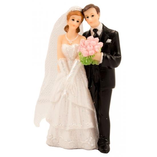 Bruidspaar met boeket taart decoratie