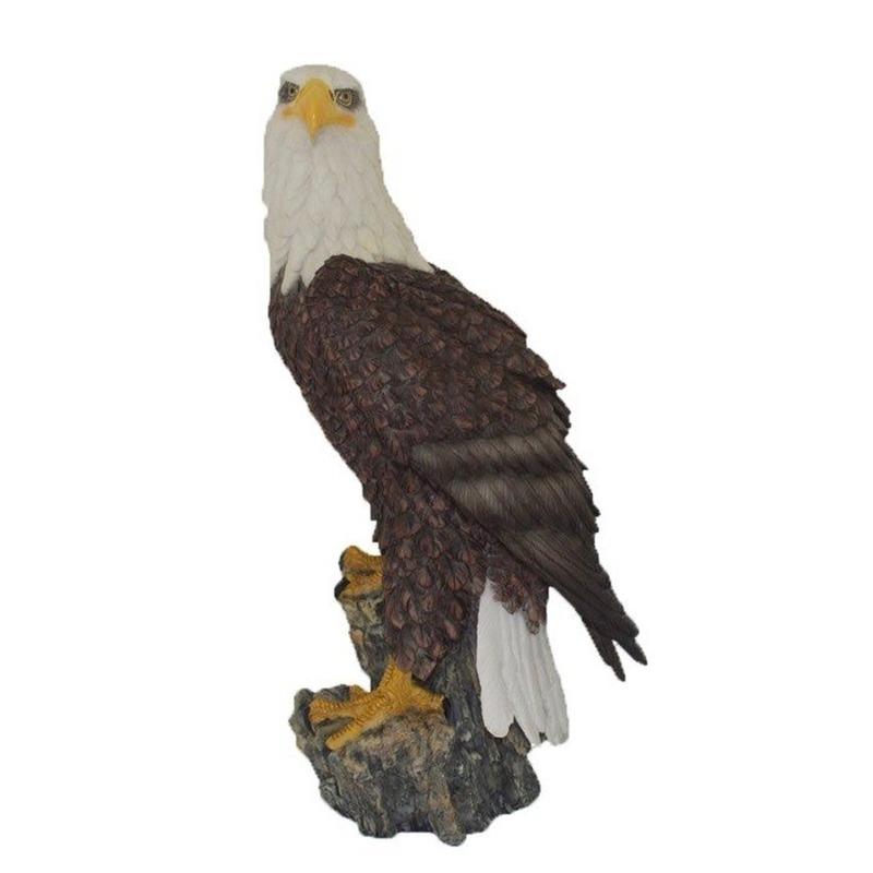 Dierenbeeld zeearend vogel staand op stam 41 cm