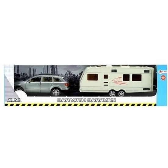 Grijze speelgoed auto met caravan aanhanger